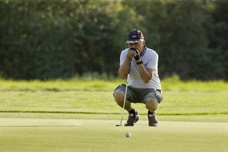 concentrating on golf