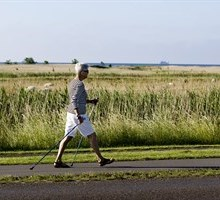 elderly person power walking in the country side