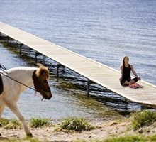 Meditating by a lake and horseback riding