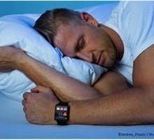 man sleeping with smartwatch